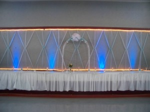 Blue uplighting head table Bark River Sr. Center